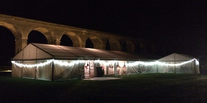 Marquee under the lit viaduct